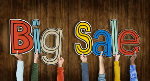 Group of Hands Holding Word Big Sale Stock Photo