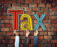 Group of Hands Holding the Word Tax Royalty Free Stock Photos