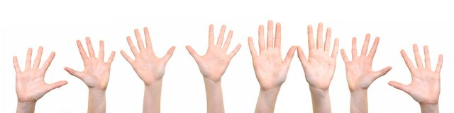 Group of hands raised up stock images