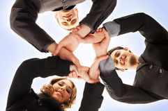 A group handshake between three business persons Stock Image