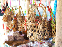 Group of hanging bamboo baskets for quail eggs. Stock Images