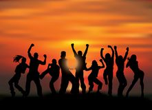 Group happy active people silhouettes and sunset. Royalty Free Stock Photography