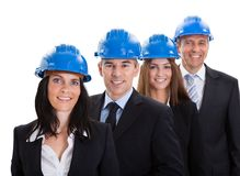 Group Of Happy Architects Standing In A Row Stock Photo