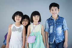 Group of Happy asian child on gray background Stock Photo