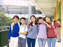 Group of happy asian elementary school student. Group of happy smiling primary school student posing on corridor of classroom building Stock Images