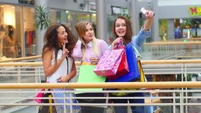 Group of happy best friends with shopping bags stock video footage
