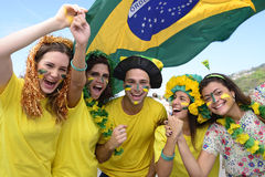 Group of happy brazilian soccer fans Stock Photo