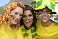 Group of happy brazilian soccer fans commemorating victory. stock image