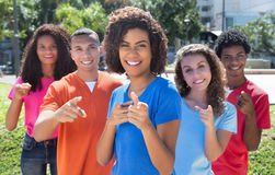 Group of happy brazilian young adults pointing at camera Royalty Free Stock Image