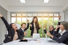 Group of happy business people cheering in office. Celebrate success. Business team celebrate a good job in the office. Asian royalty free stock image