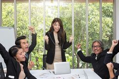 Group of happy business people cheering in office. Celebrate success. Business team celebrate a good job in the office. Asian royalty free stock images