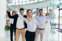 Happy business people and company staff in modern office, representig company. Group of happy business people and company staff in modern office, representig stock photography