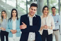 Happy business people and company staff in modern office, representig company. Group of happy business people and company staff in modern office, representig royalty free stock photo