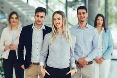 Happy business people and company staff in modern office, representig company. Group of happy business people and company staff in modern office, representig stock image