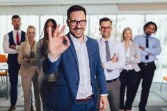 Happy business people and company staff in modern office, representig company.Selective focus royalty free stock photo