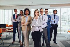 Happy business people and company staff in modern office, representig company.Selective focus. Group of happy business people and company staff in modern office royalty free stock image