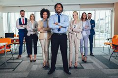 Happy business people and company staff in modern office, representig company.Selective focus. Group of happy business people and company staff in modern office royalty free stock photography