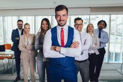 Happy business people and company staff in modern office, representig company.Selective focus. Group of happy business people and company staff in modern office royalty free stock photo