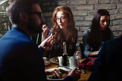 Group of happy business people eating in restaurant royalty free stock image