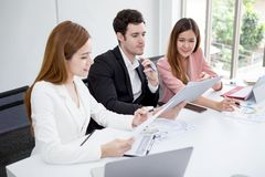 Group of happy business people men and woman working together with paper document file in meeting room.teamwork of two girl asian stock photo