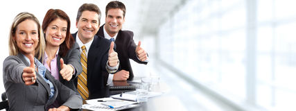Group of happy business people. Group of happy business people over blue office background Stock Photography