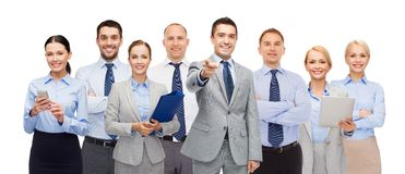 Group of happy business people pointing at you. Business, people, corporate, teamwork and office concept - group of happy businesspeople pointing at you Royalty Free Stock Images