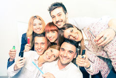 Group of happy business people taking selfie at office Stock Images
