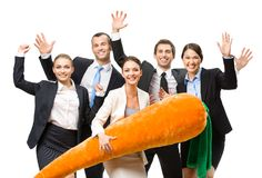Group of happy business people with toy carrot Stock Photo