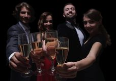Cheerful people celebrating a sucess with Champagne Royalty Free Stock Images