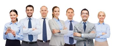 Group of happy businesspeople with crossed arms. Business, people, corporate, teamwork and office concept - group of happy businesspeople with crossed arms Stock Photos