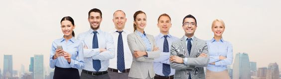 Group of happy businesspeople with crossed arms Royalty Free Stock Images