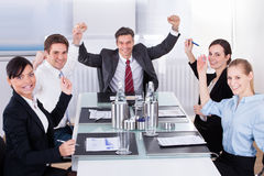 Group Of Happy Businesspeople. Group Of Excited Multi Ethnic Businesspeople In Office royalty free stock image