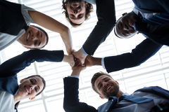 Group of happy businesspeople giving high five to each other Royalty Free Stock Photography