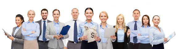 Group of happy businesspeople with money bags Royalty Free Stock Image