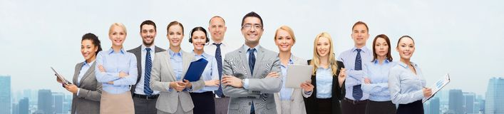 Group of happy businesspeople over city background Royalty Free Stock Photo