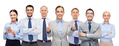Group of happy businesspeople showing thumbs up Royalty Free Stock Photo