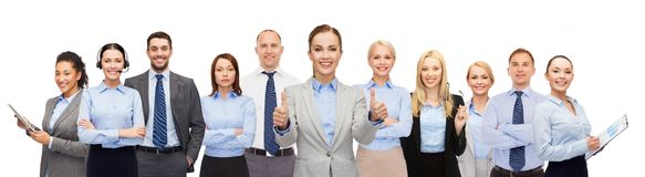 Group of happy businesspeople showing thumbs up Stock Photos