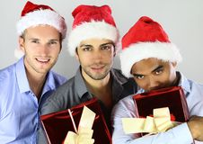 Group of happy cheerful multiracial friends in christmas hats celebrating Royalty Free Stock Photo