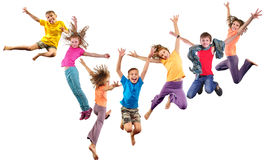 Group of happy cheerful sportive children jumping and dancing. Large group of happy cheerful sportive children jumping and dancing. Isolated over white Stock Photos