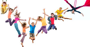 Group of happy cheerful sportive children jumping and dancing Stock Images