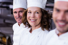 Group of happy chefs smiling at the camera Royalty Free Stock Photos