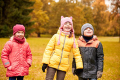 Group of happy children in autumn park Stock Photography
