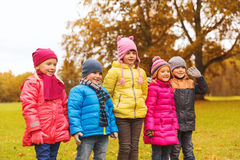 Group of happy children in autumn park Stock Photos