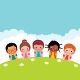Group of happy children boys and girls lying on the grass Royalty Free Stock Images