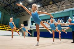 Little girls doing exercise in gym royalty free stock images