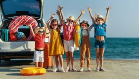 Group happy children girls and boys friends    on the car ride to summer trip royalty free stock photo