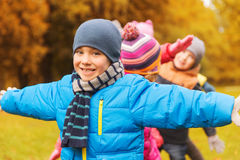 Group of happy children having fun in autumn park Royalty Free Stock Image