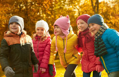 Group of happy children having fun in autumn park Royalty Free Stock Photos