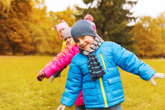 Group of happy children having fun in autumn park Stock Images