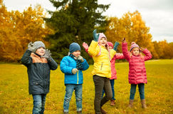 Group of happy children having fun in autumn park Stock Image